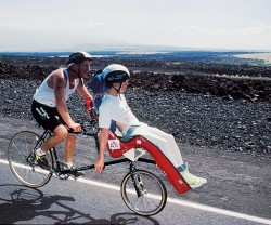Dick and Rick competing in the Hawaiian Ironman. © Courtesy of Team Hoyt