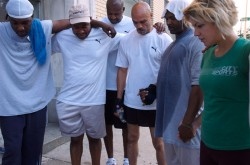 Back on My Feet members pray before their run.
