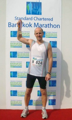 Bernd with his marathon finisher medal.