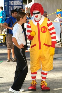 Uta and sponsor Ronald McDonald discuss running shoes. © Take The Magic Step®
