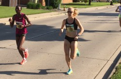 Risper Gesabwa and Kaitlin Gregg Goodman ran side by side on this warm day in Green Bay. © Michael Reger