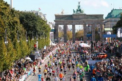 Competitors cross the finish line in front of the Brandenburg Gate in Berlin. © www.PhotoRun.net