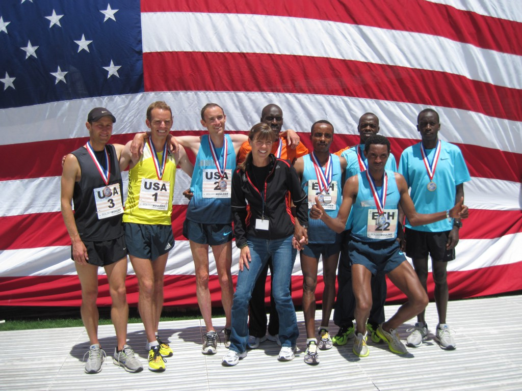 The top-three teams Kenya (Lani Rutto, Allan Kiprono, Leonard Korir), Ethiopia (Birhanu Gedefa, Belete Assefa), and America (Kenyon Nueman, Aaron Braun, Brent Vaughn) celebrate a great competition on Memorial Day. © Uta Pippig and Take The Magic Step®