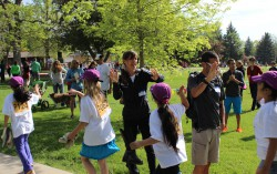 """High Fives"" with the Columbine Kids and Uta before their 37th Columbine Mile Marathon in Boulder. © Take The Magic Step"
