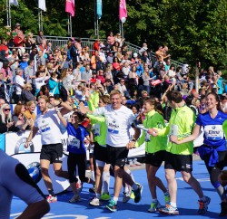50 meters before the finish line together with the RTL charity marathon relay. ©Take The Magic Step