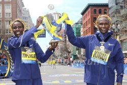 Edna Kiplagat and Geoffrey Kirui celebrate on Boylston Street after their exciting races. ©www.PhotoRun.net