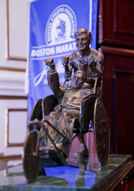 John Hancock Financial commissioned a statue to capture the inspiring character and spirit of Dick and Rick Hoyt. The life-sized statue was unveiled in April 2013 at the Center School in Hopkinton. © Courtesy of Team Hoyt