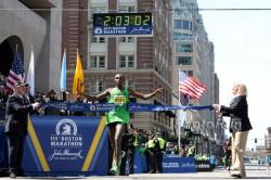 Geoffrey Mutai crossed the finish line beside the Boston Library in a world-best time of 2:03:02 in April, 2011. ©www.photorun.net
