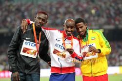 Caleb Ndiku, Mo Farah, and Hagos Gebrhiwet medaled in the 5,000m. © www.PhotoRun.net