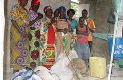 These needy widows had their grain ground for free thanks to PeopleWeaver. © Courtesy of PeopleWeaver